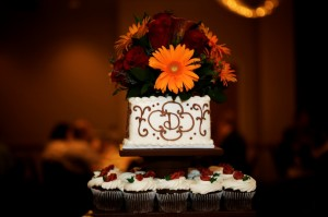 Red Roses, Mango Mini Callas, and Orange Gerberas On Top of Cake
