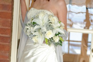 White Lilies and Roses with wintery accents