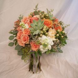 Real wedding flowers in red pink orange and yellow blossom basket florist mightylinksfo