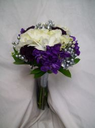 Bridesmaids bouquet with white, purple, and silver