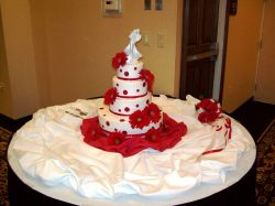 Wedding Cake with Red Gerber Daisies