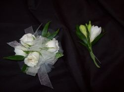 White petite bloomed corsage & boutonniere