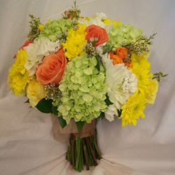 Real wedding flowers in red pink orange and yellow blossom basket florist wedding mightylinksfo